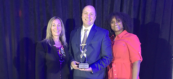 Jennifer Raley, Jeff Shaw, and Lezael Rorie accept the Smart Electric Power Alliance's 2019 Electric Cooperative of the Year award on behalf of SMECO