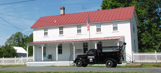 SMECO's replica 1939 line truck in front of the historic Bushwood post office